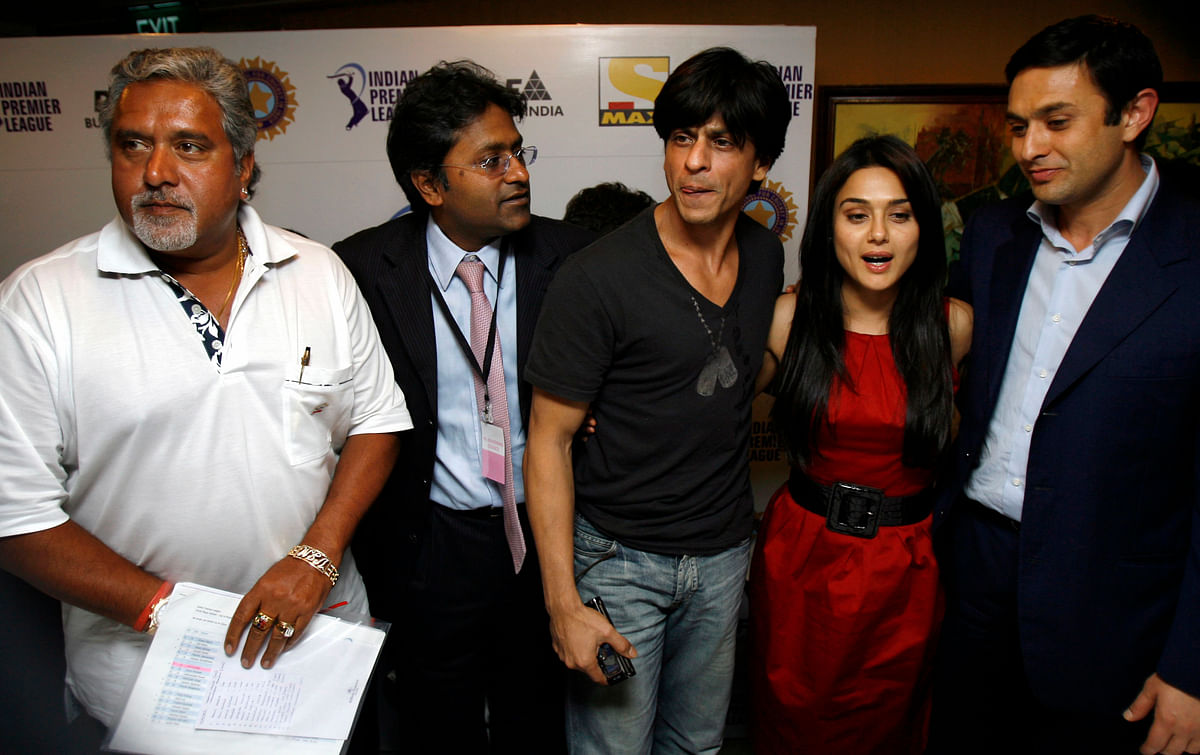 Indian industrialists Vijay Mallya (L), Ness Wadia (R), IPL official Lalit Modi (2nd L) and actors Shah Rukh Khan (C) and Preity Zinta pose during a news conference after the Indian Premier League's (IPL) player auction in Mumbai on 20 February 2008.