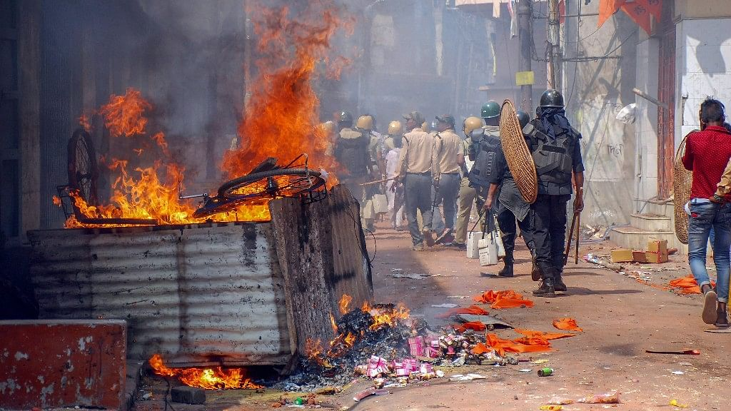 Police personnel patrol the area after a clashes and incidents of arson over Ram Navami procession at Raniganj in Burdwan district.