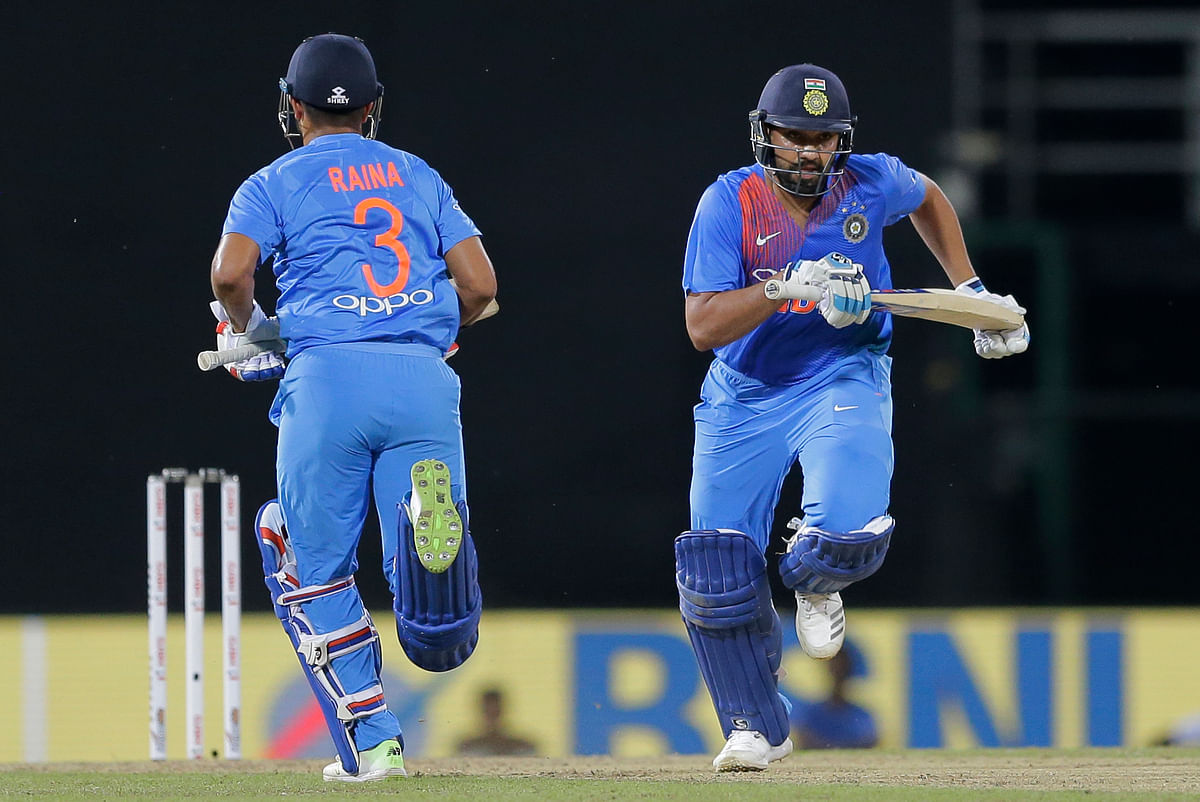 India's Rohit Sharma, right, and Suresh Raina run between wickets against Bangladesh during their second Twenty20 cricket match in Nidahas triangular series in Colombo, Sri Lanka