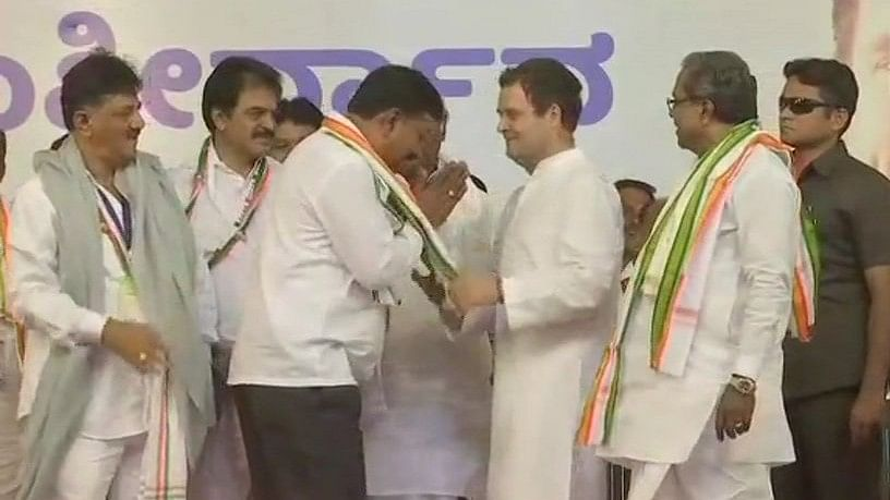 Seven rebel JD(S) MLAs joined the ruling Congress on 25 March in the presence of party president Rahul Gandhi.