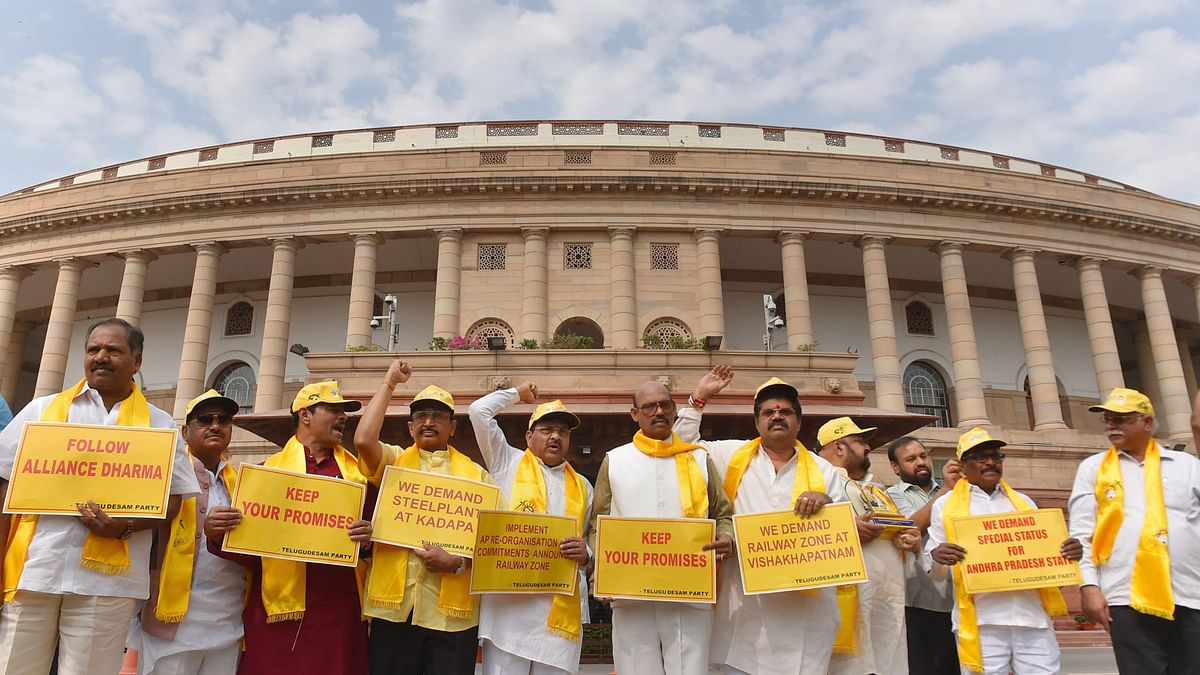 TDP party leaders hold placards and raise slogans demanding special status for Andhra Pradesh during the budget session.