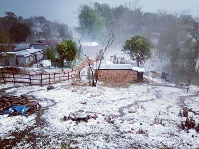 Mawshynrut village in Meghalaya's West Khasi Hills district covered by hailstones on Friday.