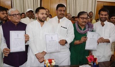 Patna: RJD leaders and newly elected Rajya Sabha members Manoj Jha and Ashfaq Karim and Congress leader and newly elected Rajya Sabha member Akhilesh Singh with RJD leaders Tejashwi Yadav and Tej Pratap Yadav in Patna on March 15, 2018. (Photo: IANS)