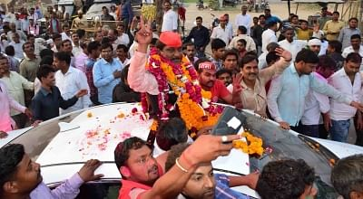 Allahabd: Samajwadi Party candidate Nagendra Singh Patel celebrates his win after being elected to the Lok Sabha from Phulpur, in Allahabad on March 14, 2018. According to the Election Commission, he defeated his nearest BJP opponent by 59,613 votes. (Photo: IANS)
