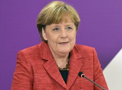 Merkel welcomes SDP vote for coalition deal