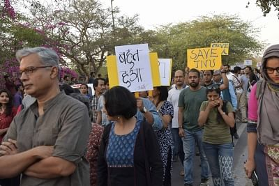 New Delhi: Students and teachers of JNU stage a demonstration to protest against removal of Dean of School of Arts Kavita Singh at university campus in New Delhi on March 17, 2018. (Photo: IANS)