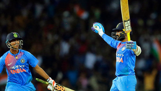 Dinesh Karthik celebrates after helping India defeat Bangladesh in the Nidahas Trophy T20 tri-series final.