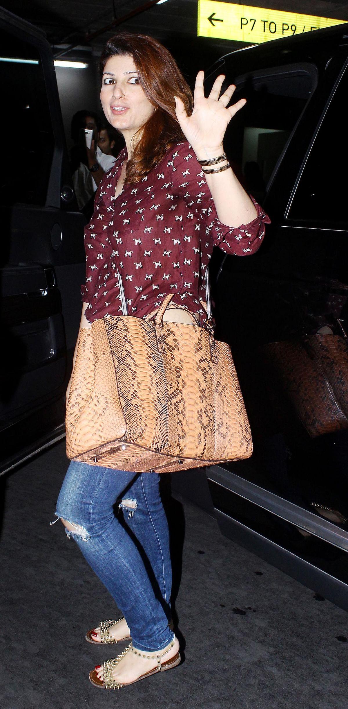 Filmmaker Twinkle Khanna made a face at husband Akshay Kumar's onesie.