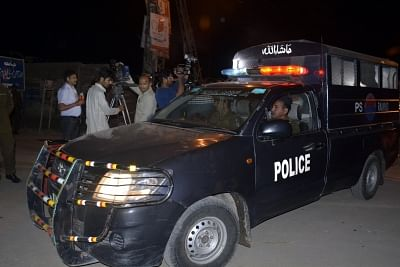 LAHORE (PAKISTAN), March 14, 2018 (Xinhua) -- A police vehicle patrols near a blast site in Lahore, eastern Pakistan, on March 14, 2018. At least one person was killed and 20 others injured including several policemen on Wednesday evening in a blast in Pakistan