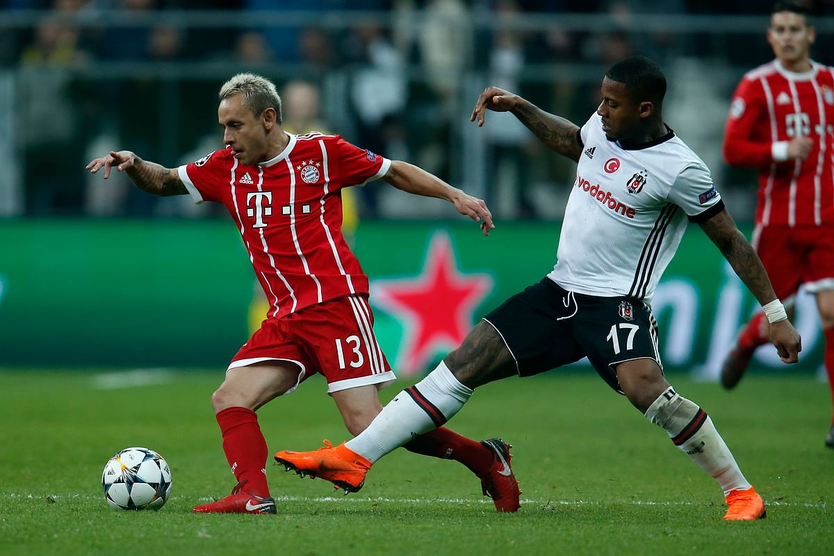 Bayern's Rafinha, left, and Besiktas' Jeremain Lens challenge for the ball during the Champions League, round of 16, second leg, soccer match between Besiktas and Bayern Munich at Vodafone Arena stadium in Istanbul, Wednesday, March 14, 2018.