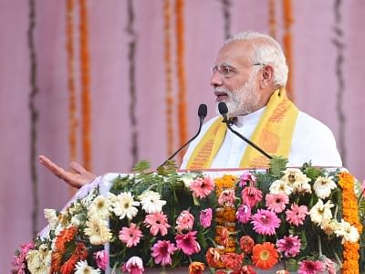 Varanasi: Prime Minister Narendra Modi addresses a public meeting in Varanasi, Uttar Pradesh on March 12, 2018. (Photo: IANS/PIB)