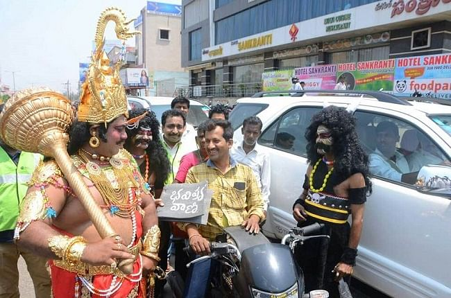 Actors round-up a traffic rule violator.