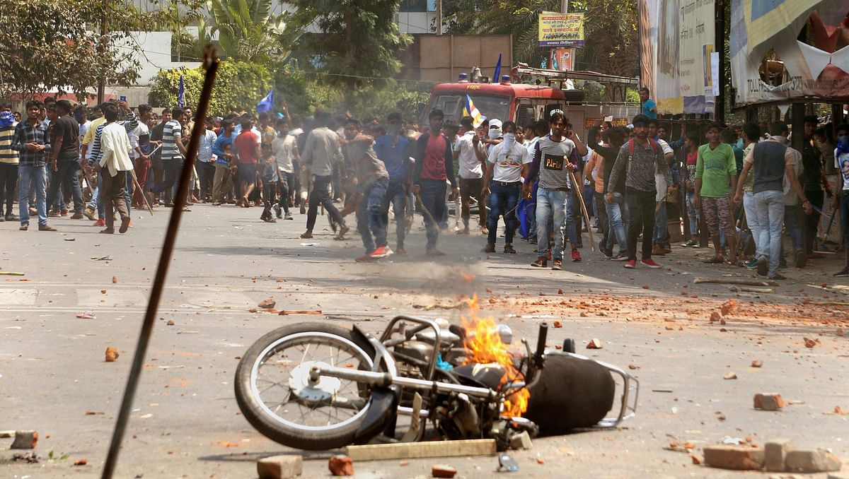 A bike set on fire by a group of protesters during Bharat Bandh call given by Dalit organisations against the alleged dilution of the SC/ST Act, in Meerut on 2 April 2018.