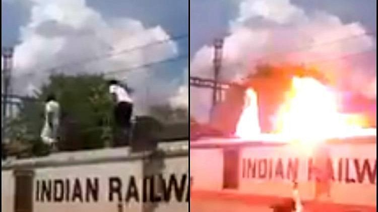 Ranjith and another cadre can be seen running on top of a train clearly ignoring the high-tension wires above their heads.