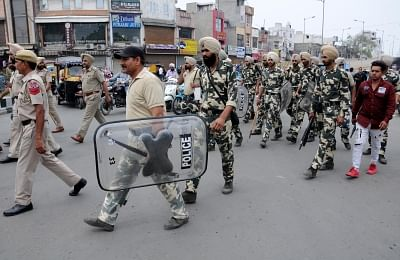 """Amritsar: Security personnel conduct a flag march during """"Bharat Bandh"""" called by various groups to protest against reservation policies, in Amritsar on April 10, 2018. (Photo: IANS)"""