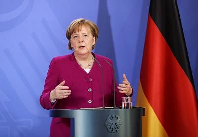 MESEBERG, April 11, 2018 (Xinhua) -- German Chancellor Angela Merkel attends a press conference with German vice Chancellor and Finance Minister Olaf Scholz (not in photo) after a German cabinet meeting in Meseberg, Germany, on April 11, 2018. (Xinhua/Shan Yuqi/IANS)
