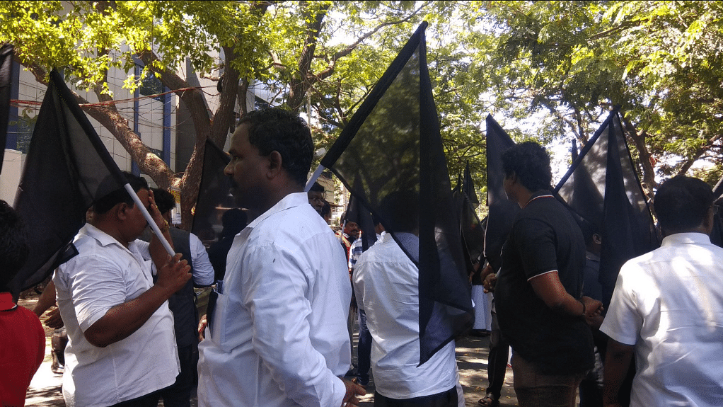 Protesters hold black flags condemning PM Modi's visit to Chennai in view of the ongoing Cauvery dispute.