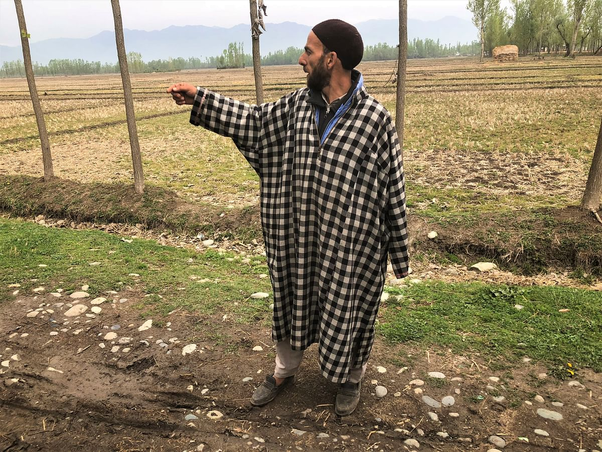 Bhat's uncle pointing in the direction where Manzoor's beheaded body was found on Friday.