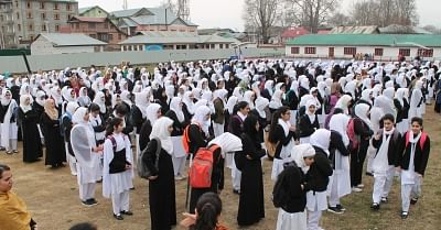 Srinagar: Students assemble at their school for morning prayers as High and Higher Secondary schools re-open after winter break, in Srinagar on Feb 26, 2018. (Photo: IANS)