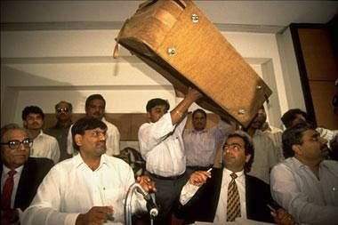 "Harshad Mehta and his legal team with the briefcase in which they allegedly paid then PM Narasimha Rao money as ""insurance."""
