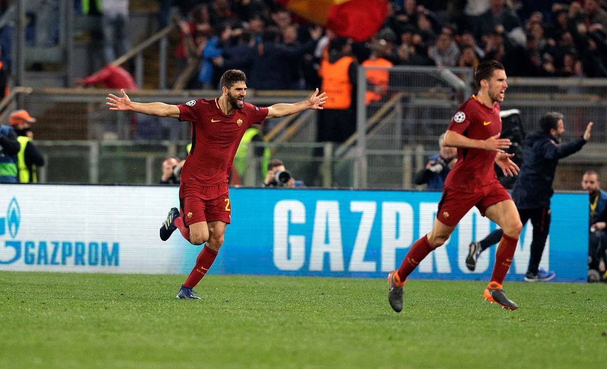 Roma's Federico Fazio, left, celebrates with teammates after Kostas Manolas scored his side's 3rd goal, during the Champions League quarterfinal second leg soccer match between Roma and FC Barcelona at Rome's Olympic Stadium, Tuesday, April 10, 2018.
