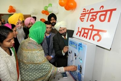 Amritsar: Girls purchase sanitary napkins from a Sanitary Napkin Vending Machines installed at Village Chogawan located on the outskirts of Amritsar, on Jan 29, 2016. (Photo: IANS)