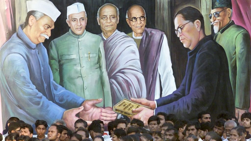 A mural depicting Balasaheb Ambedkar (right)  handing over the Constitution to Rajendra Prasad (left). To give full credit to Ambedkar alone is to do a grave disservice to others, including Nehru and Sardar Patel.
