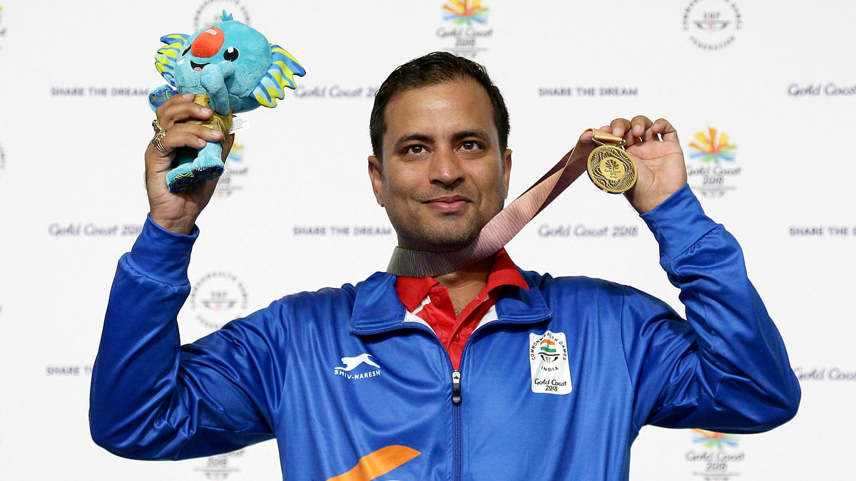 Sanjeev Rajput of India celebrates winning the gold medal at the men's 50m Rifle 3P final at the Belmont Shooting Centre during the 2018 Commonwealth Games in Brisbane, Australia