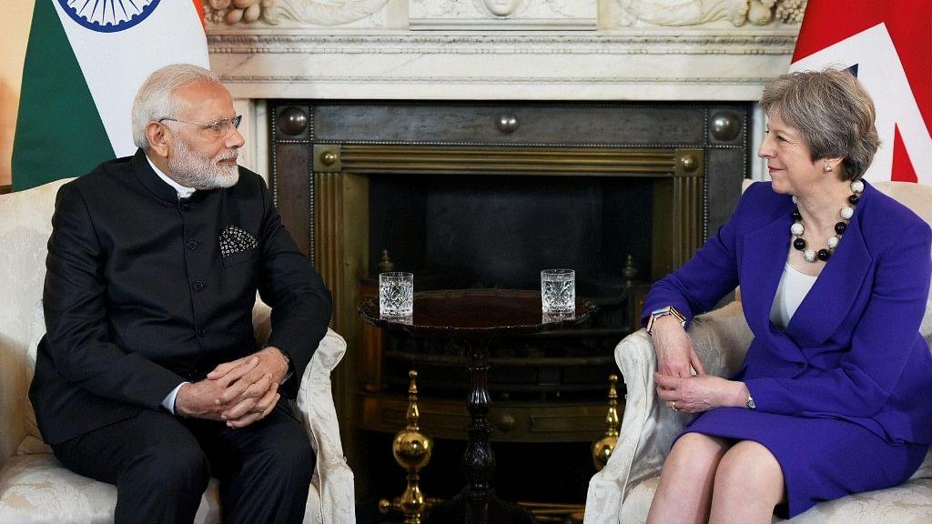 PM Modi meets Theresa May in London.