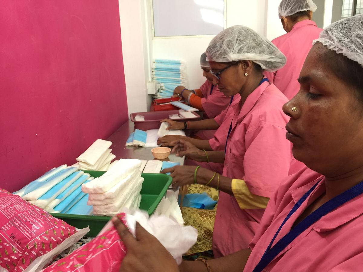 Employees at Myna Mahila Foundation make sanitary napkins in their Govandi office.