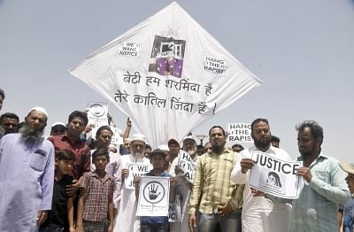 Ahmedabad: Kite makers stage a demonstration against the increasing incidents of rape, in Ahmedabad on April 22, 2018. (Photro: IANS)