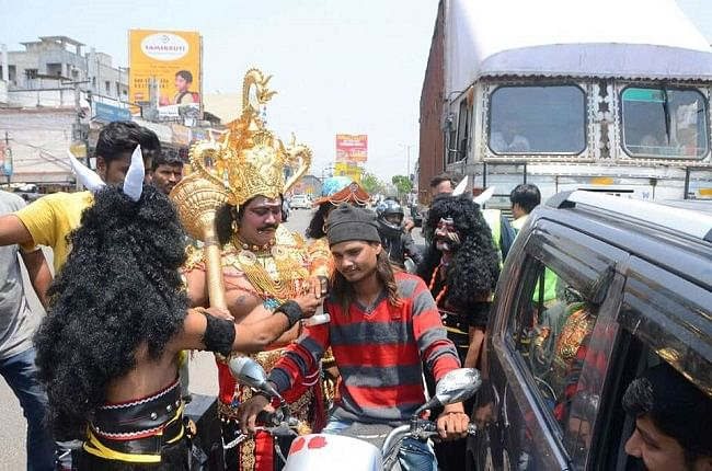 Actors round-up a traffic rules violator