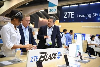 SAN FRANCISCO, Sept. 12, 2017 (Xinhua) -- People visit the booth of Chinese telecommunication firm ZTE Corporation during the 2017 Mobile World Congress Americas (MWCA) in San Francisco, the United States on Sept. 12, 2017. 2017 Mobile World Congress Americas is held here from Sept. 12 to Sept. 14. (Xinhua/Wu Xiaoling/IANS)