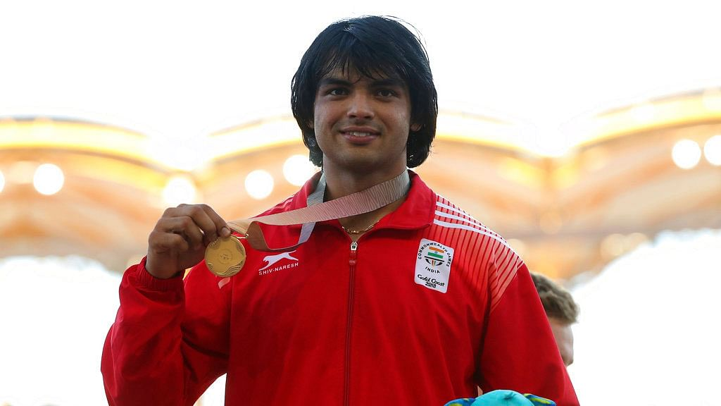 Neeraj Chopra poses with his gold medal at the 2018 Commonwealth Games.