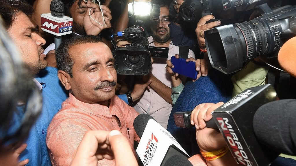 BJP MLA from Unnao Kuldip Singh Sengar, accused in a rape case, surrounded by media persons outside the office of the Senior Superintendent of Police in Lucknow on Wednesday night.