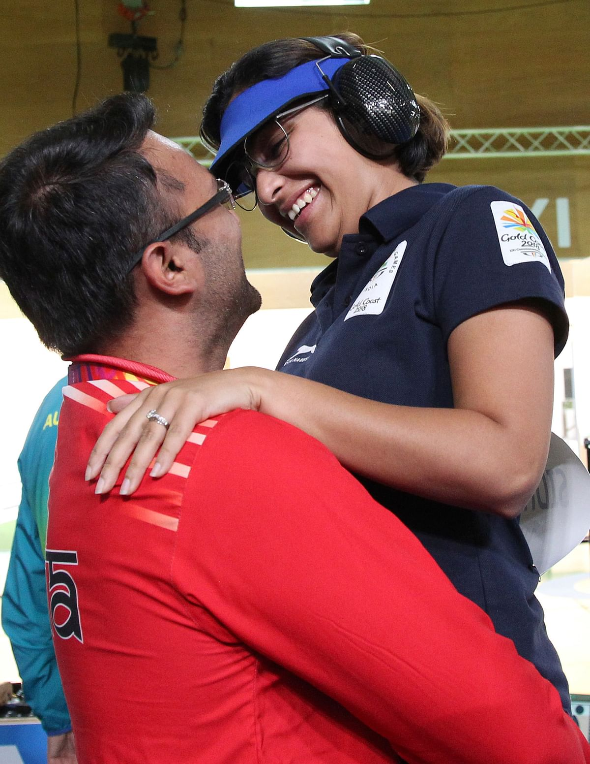 Heena Sidhu, right, celebrates with her husband and coach Ronak Pandit, left, after winning the gold medal during the women's 25m Pistol final at the Belmont Shooting Centre during the 2018 Commonwealth Games in Brisbane