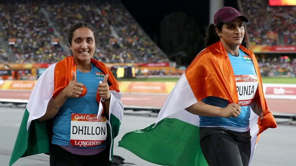 Women's discus silver medalist India's Seema Punia right, and bronze medalist and compatriot Navjeet Dhillon celebrate at Carrara Stadium during the 2018 Commonwealth Games on the Gold Coast, Australia.