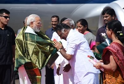 Chennai: Prime Minister Narendra Modi being welcomed by the Deputy Chief Minister of Tamil Nadu O. Panneerselvam, on his arrival, at Chennai, Tamil Nadu on April 12, 2018. (Photo: IANS/PIB)