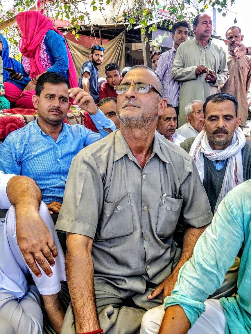Bagmal Khajuria listens as Kant Kumar, the vice president of Hindu Ekta Manch, speaks.