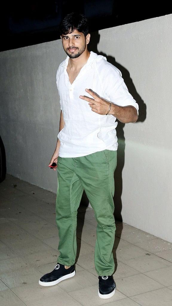 Sidharth Malhotra strikes a pose for paparazzi outside a salon in Mumbai.