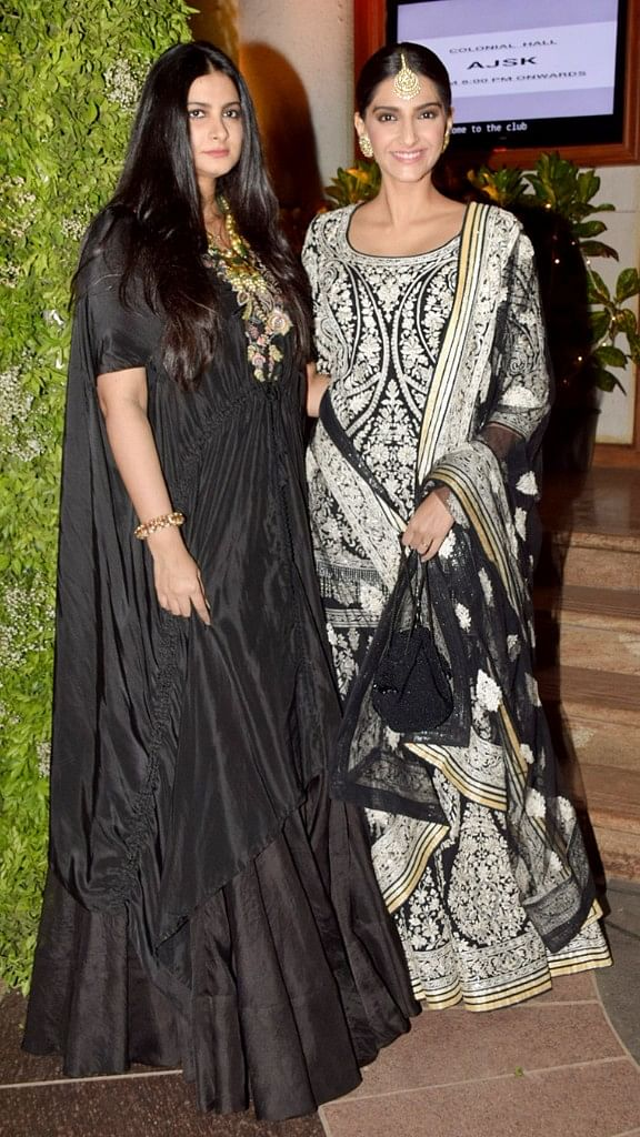 Sisters Rhea and Sonam Kapoor pose for the camera.
