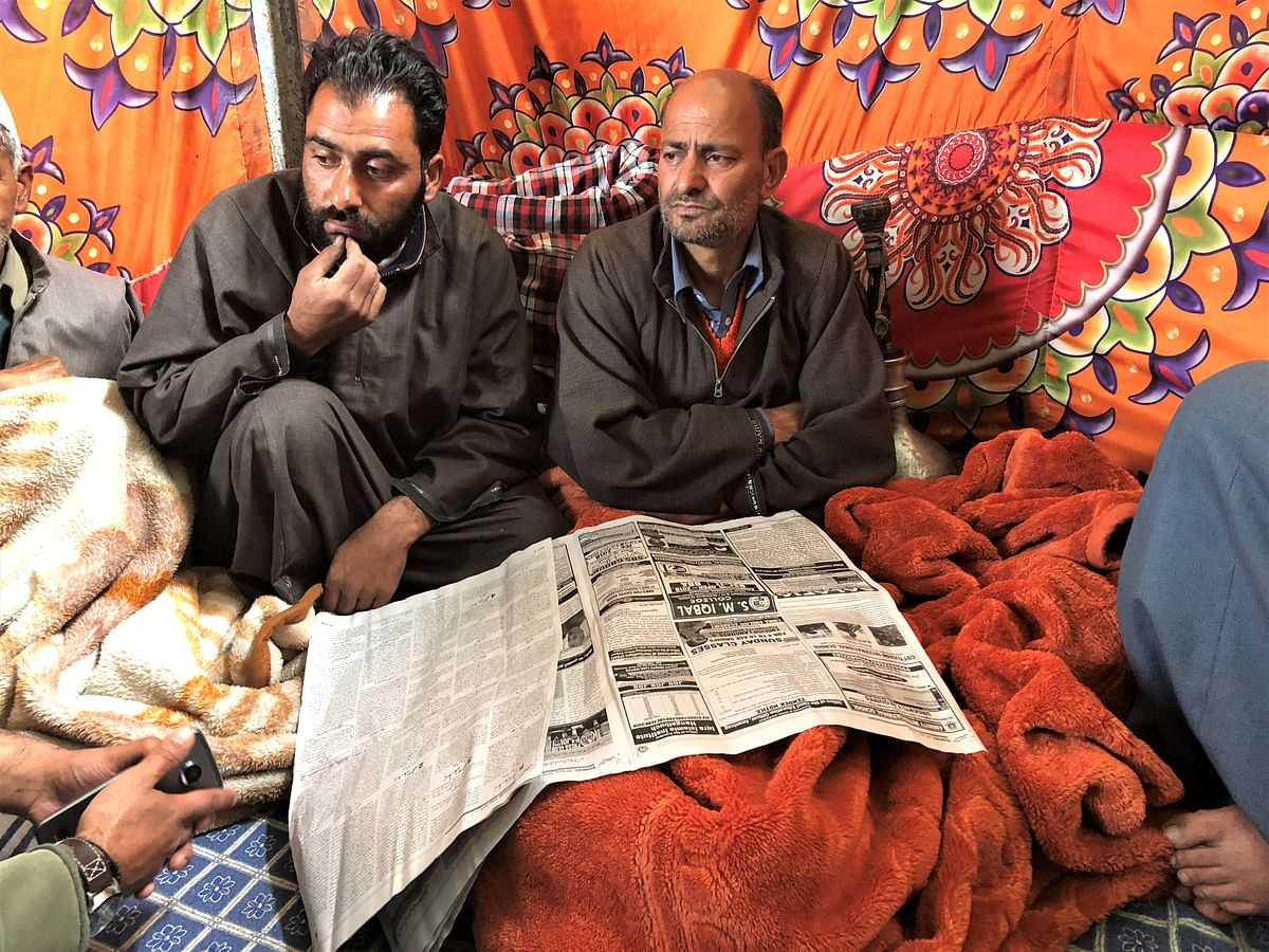 Abdul Gaffar Bhat (right) at his residence in Hajin after his son's killing.