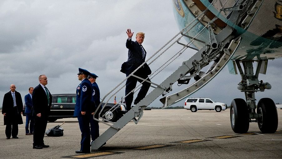 US President Donald Trump waves while boarding Air Force One.