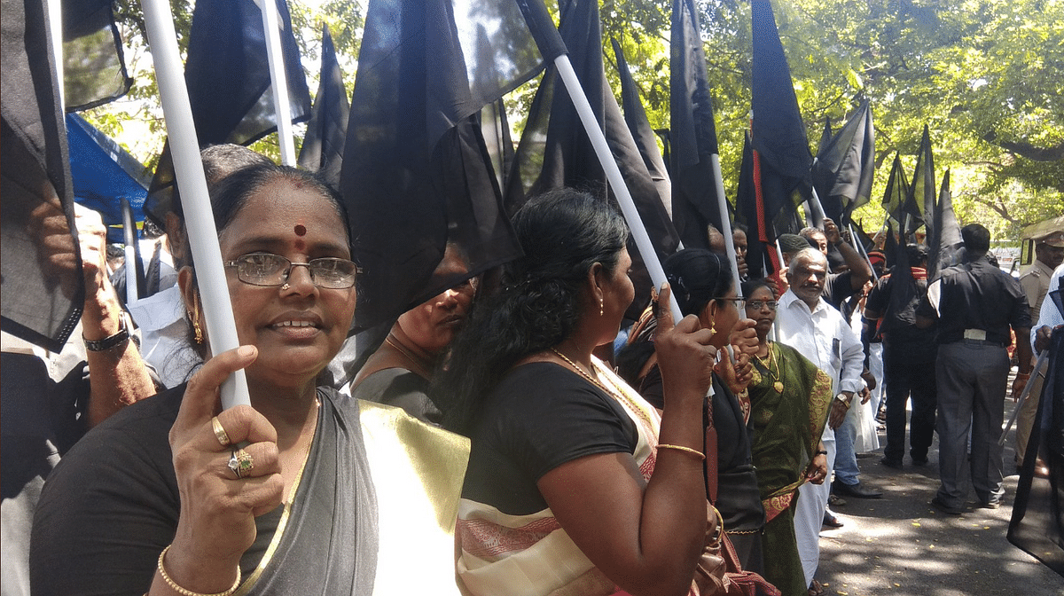 MDMK party members raise black flags condemning PM Modi who is attending the Defence Expo 2018 today.