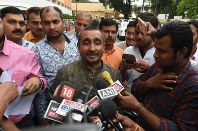 Lucknow: BJP legislator from Unnao Kuldeep Singh Sengar talks to press after meeting Uttar Pradesh Chief Minister Yogi Adityanath in Lucknow on April 9, 2018. The meeting comes after a girl tried to set herself on fire outside the Uttar Pradesh Chief Minister