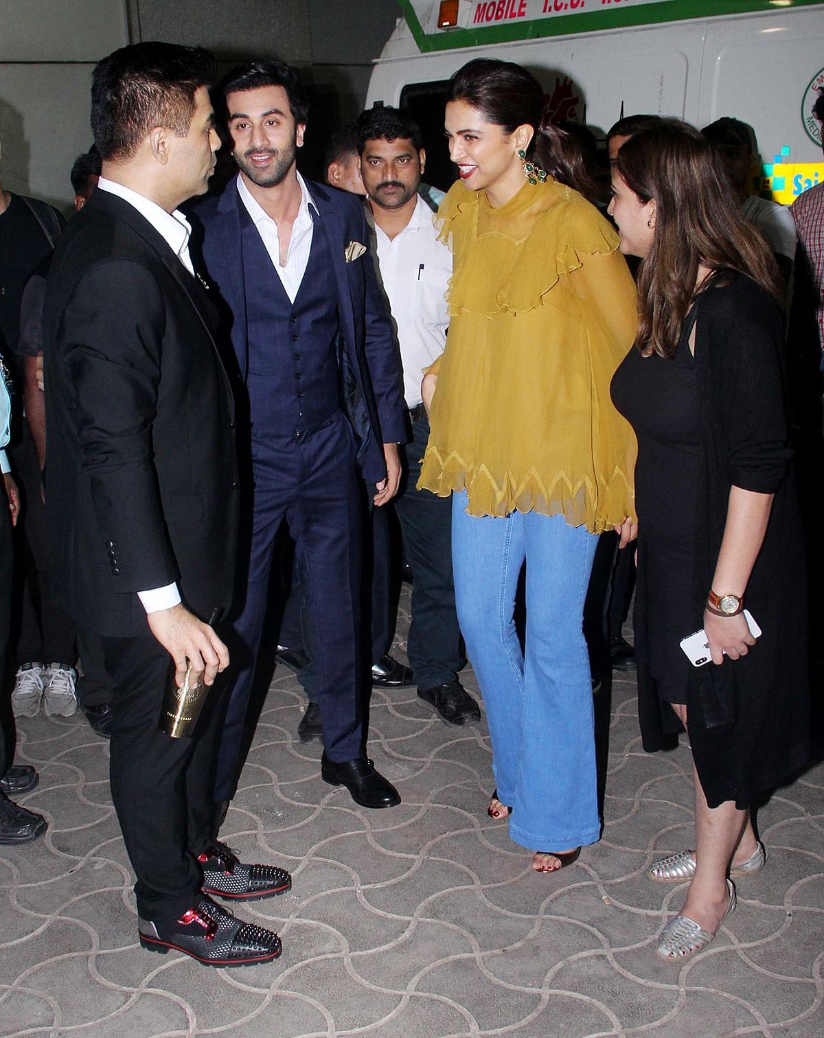 Karan Johar, Ranbir Kapoor and Deepika Padukone catch up at an event.