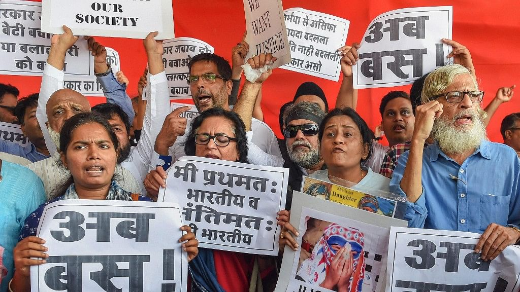 Activists from Left parties participating in a protest against the government's alleged inaction in the Kathua and Unnao rape cases, in Mumbai on Friday, 13 April.