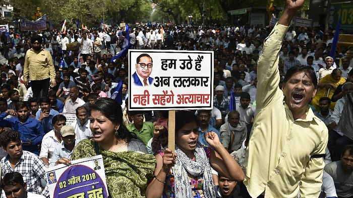 Members of the Dalit community raise slogans during Bharat Bandh against the alleged dilution of SC/ST Act in New Delhi, on 2 April 2018.