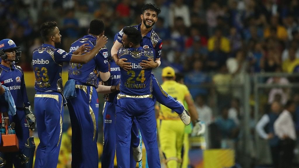 Mayank Markande celebrates with his Mumbai Indians' teammates after dismissing Mahendra Singh Dhoni in the first match of IPL 2018 on 7 April in Mumbai.
