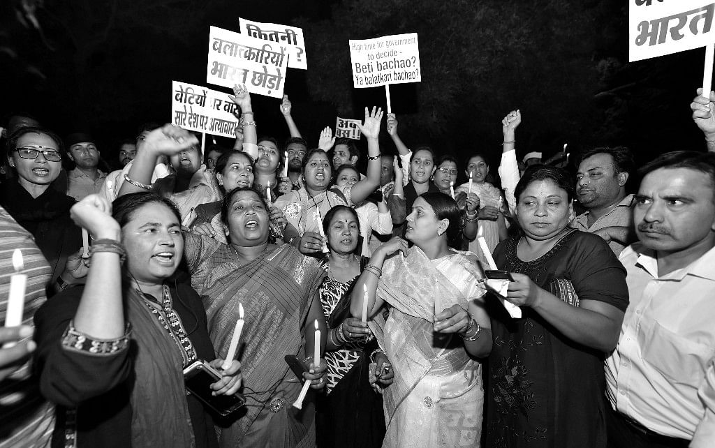 Protesters during a midnight candlelight vigil against Kathua and Unnao rape cases.